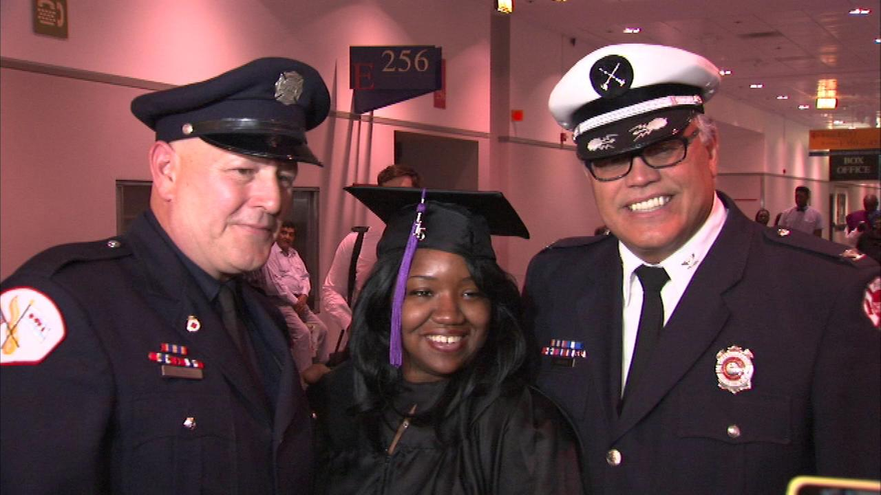 Two Chicago firefighters attended the college graduation of a woman whose life they saved 10 years ago.