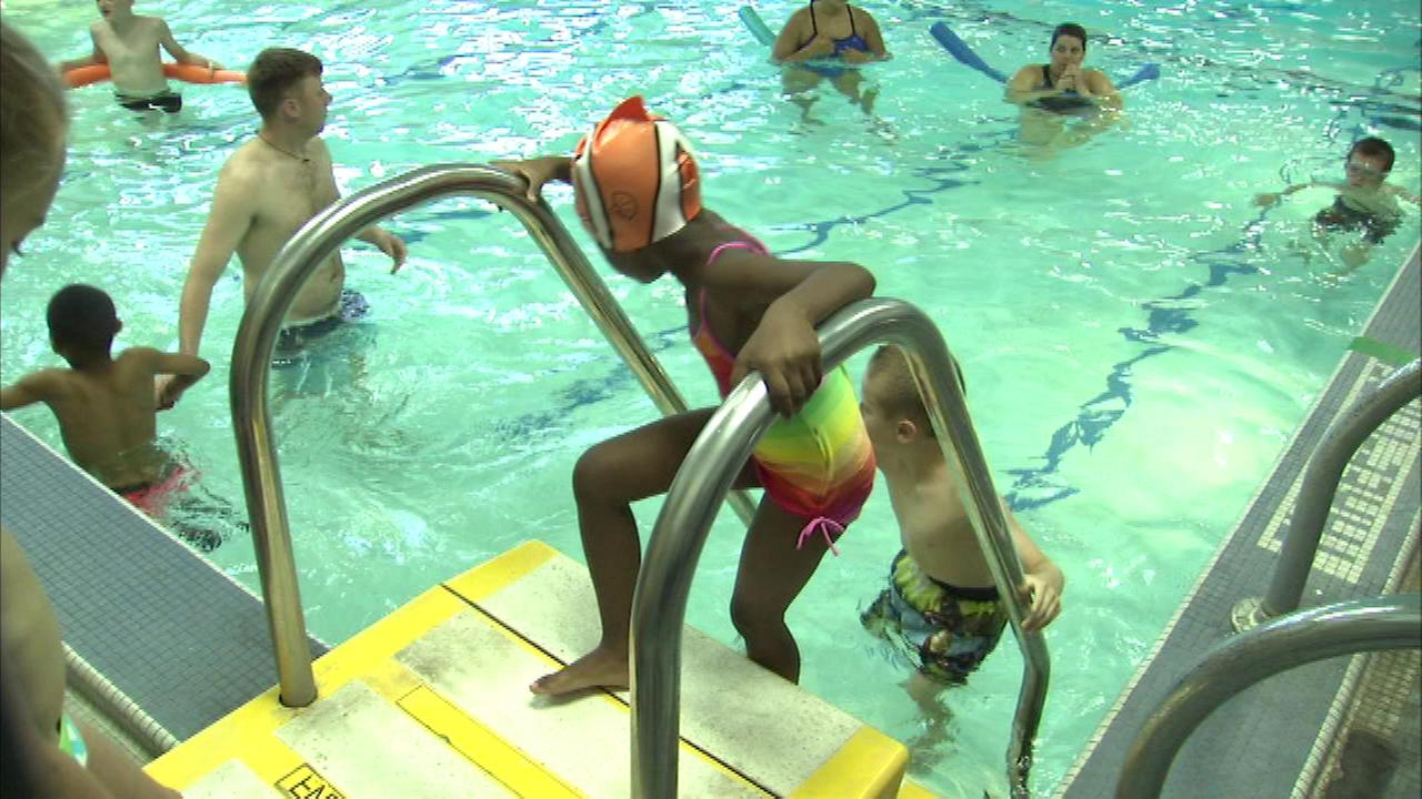 Kids dove into the first day of the ZAC Foundations swim camp at the Boys and Girls Club  in the Bridgeport neighborhood on the South Side.