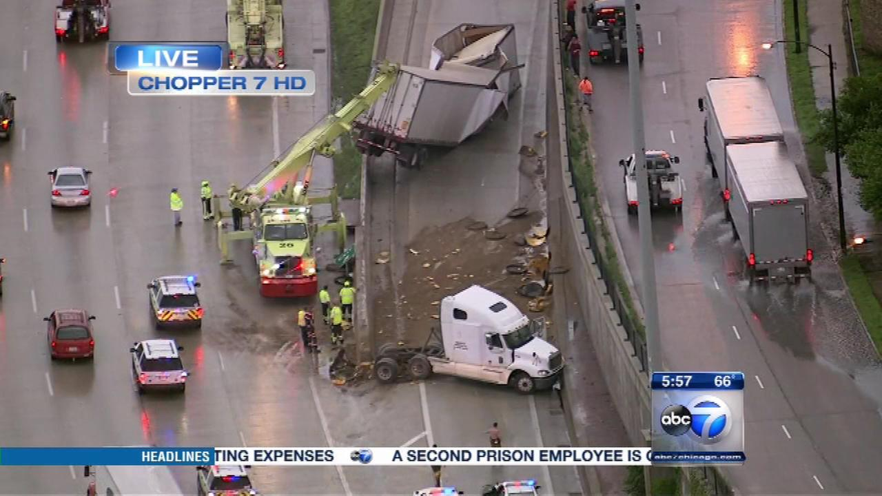 The 47th Street exit on the outbound Dan Ryan Expressway closed early Thursday after a semi-truck carrying 42,000-pounds of powered milked jackknifed over the cement wall.