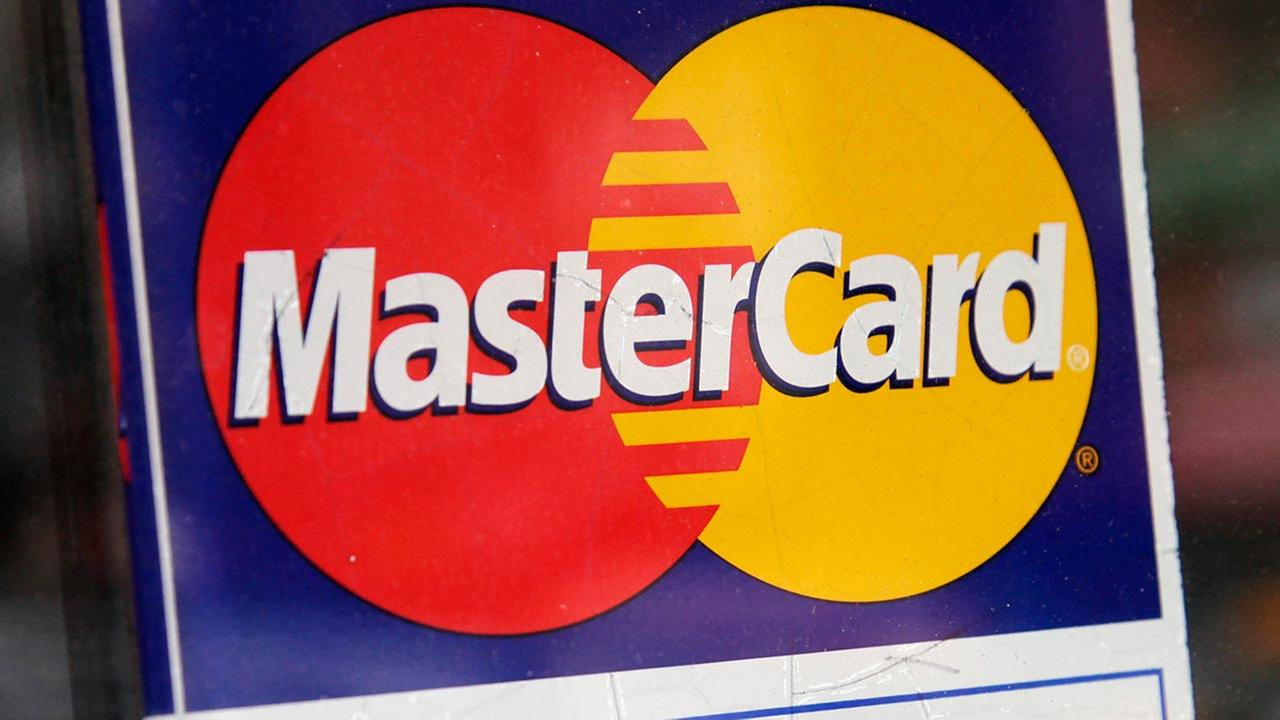 In this Jan. 21, 2015 photo, a sign indicating MasterCard credit cards are accepted is posted at a New York business.