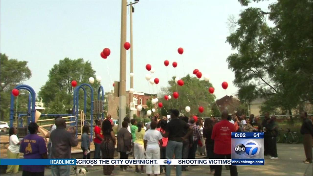 Loved ones released balloons to symbolize the hope the gun violence will end soon.