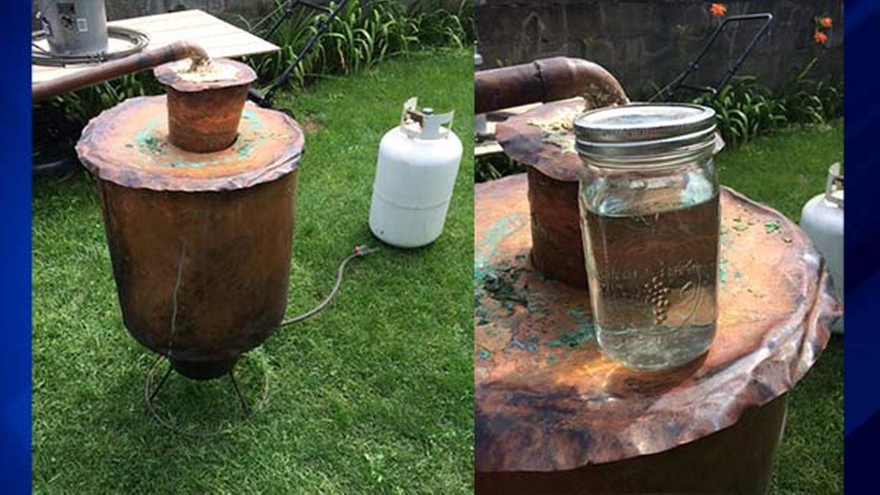 Moonshine and still seized from Lake Station residence