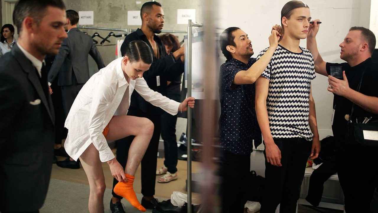 Models get ready backstage before a presentation by Thom Browne during Mens Fashion Week in New York, Tuesday, July 14, 2015.