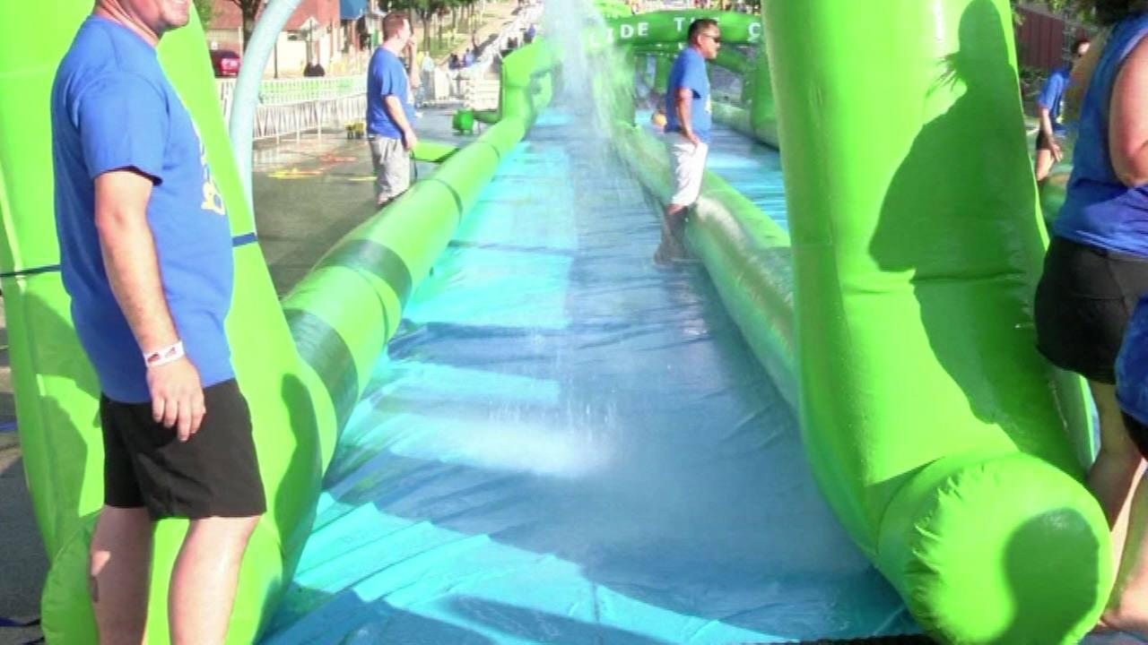 PHOTOS: 1,000-foot-long water slide returns to Peoria