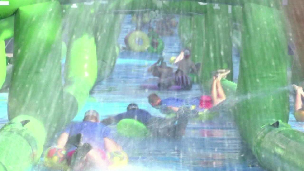 People in Peoria are finding a new way to beat the heat this weekend with a 1,000-foot water slide.