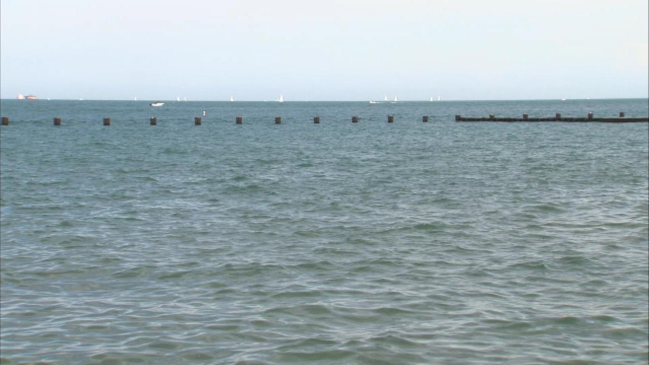A mans body is pulled from Lake Michigan on Chicagos Near North Side early Sunday morning.