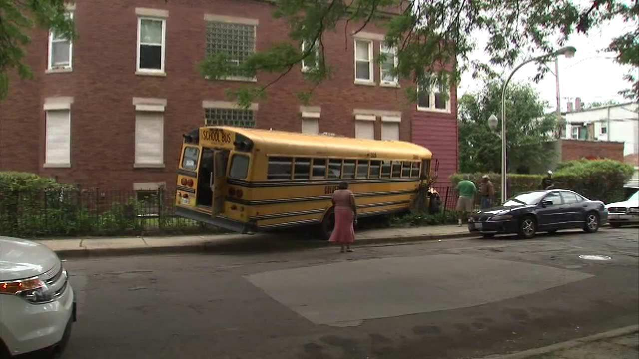 School bus drives into South Side building