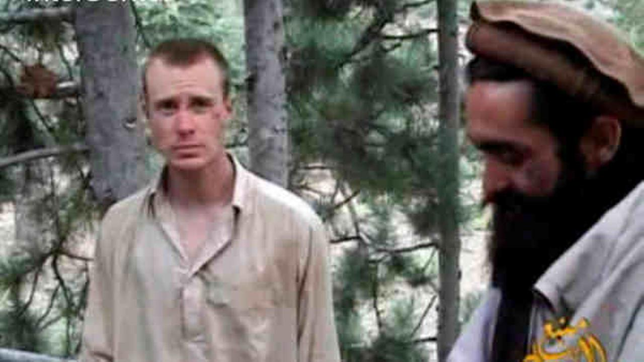 This file image provided by IntelCenter on Wednesday Dec. 8, 2010 shows a frame grab from a video released by the Taliban containing footage of a man believed to be Bowe Bergdahl.