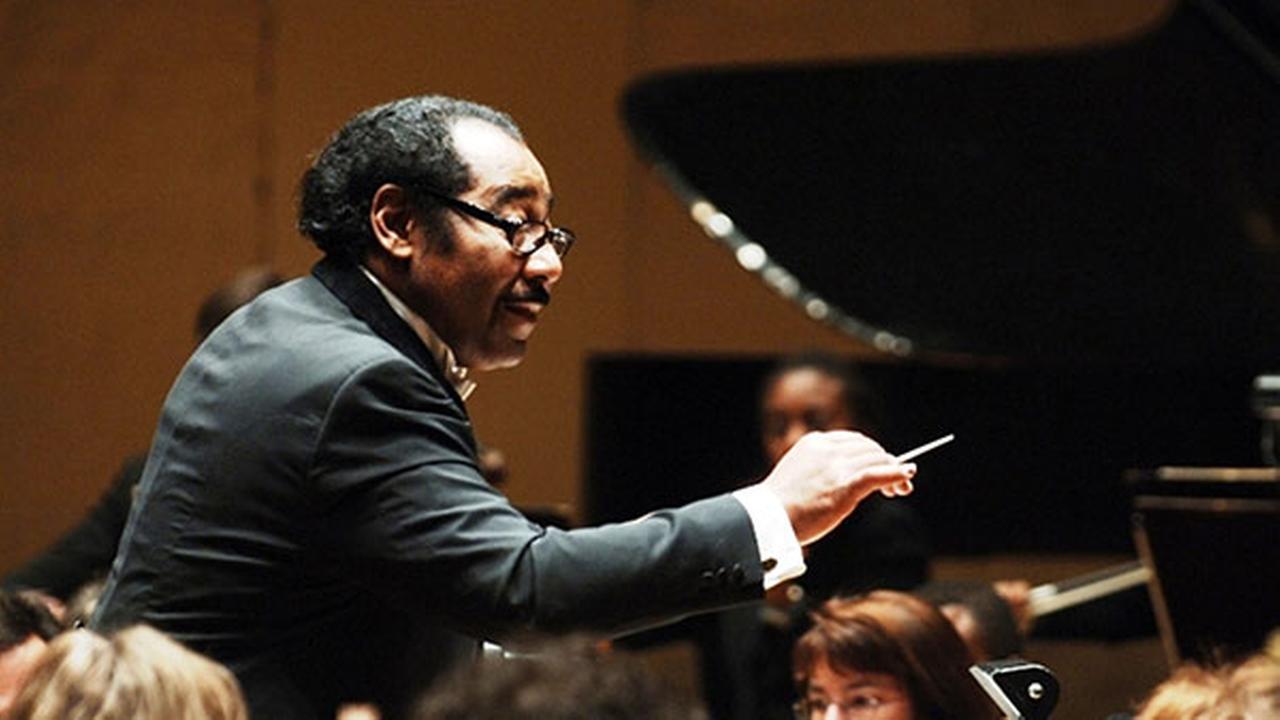 Maestro Paul Freeman, conducting.