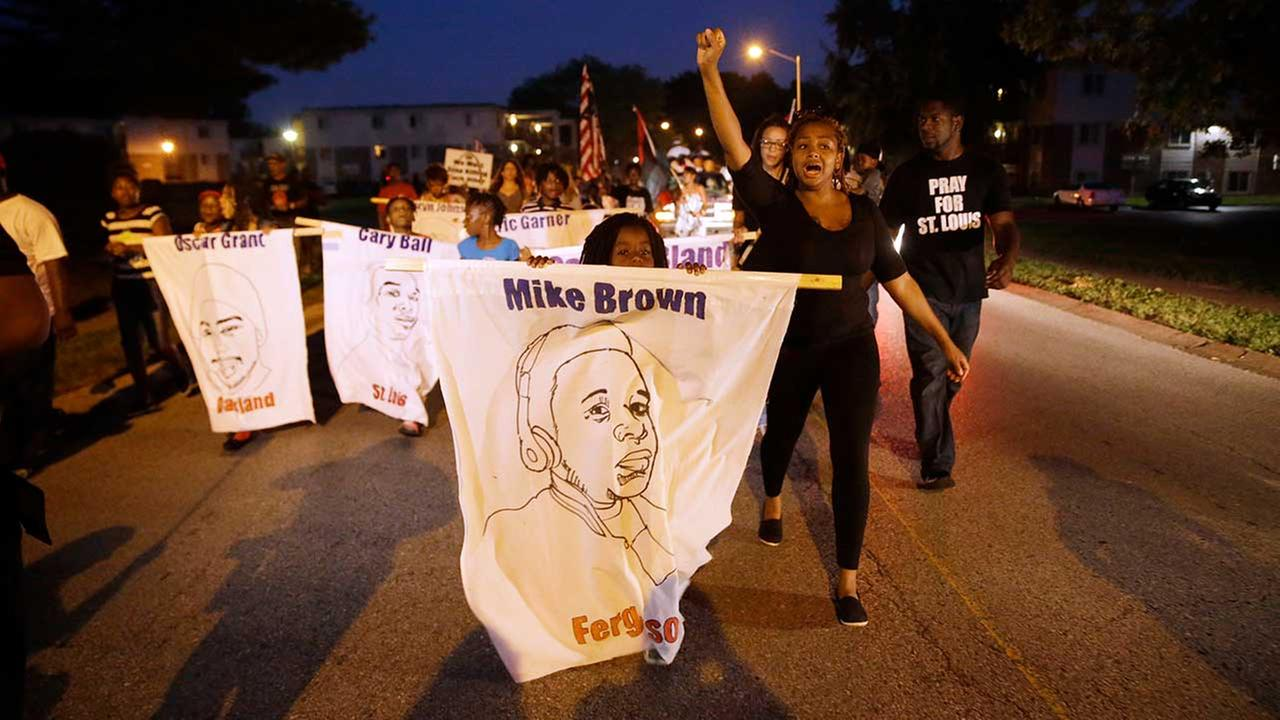 Protesters march down Canfield Drive near where Michael Brown was killed on Aug. 7, 2015, in Ferguson, Mo.