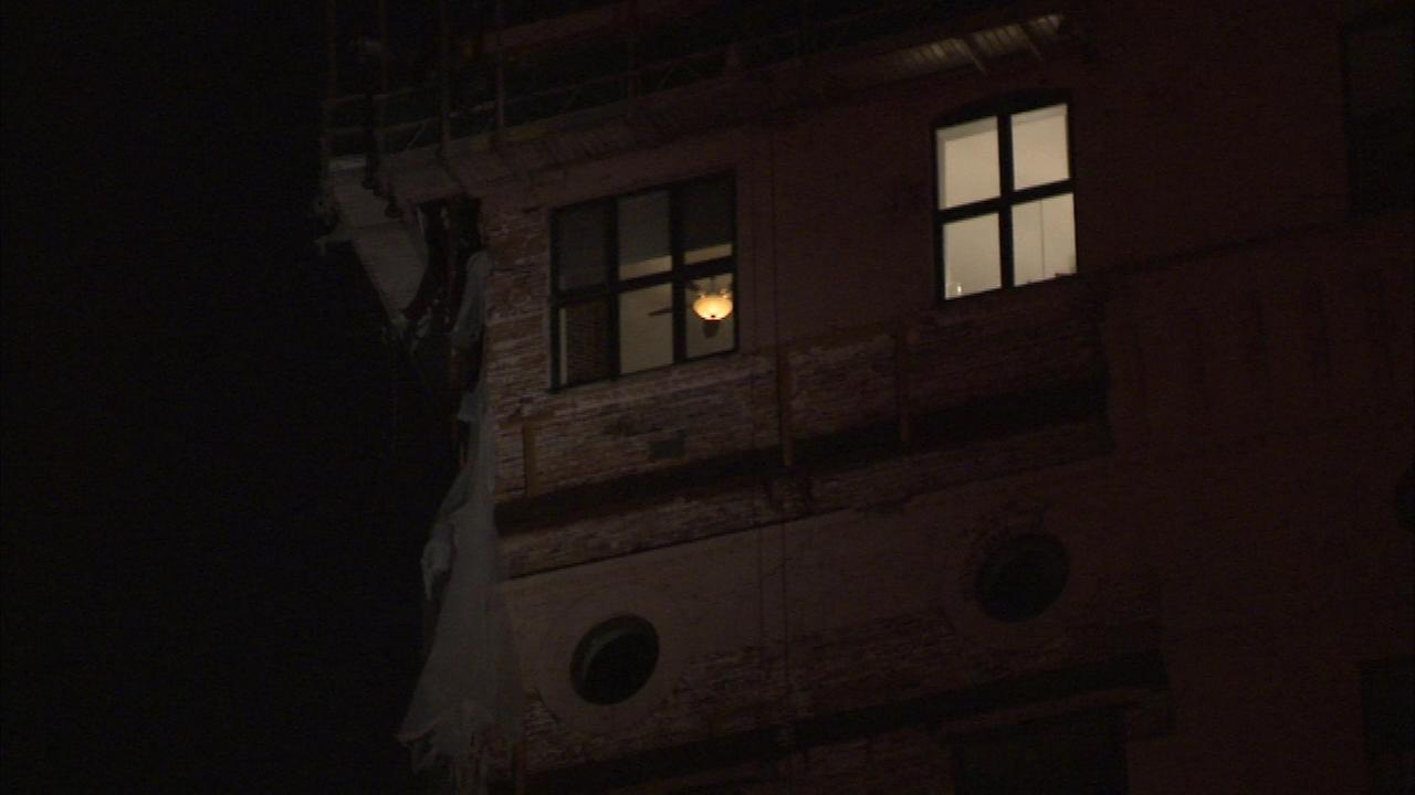 Firefighters responded after pieces of a building on the North Branch of the Chicago River collapsed Saturday night.