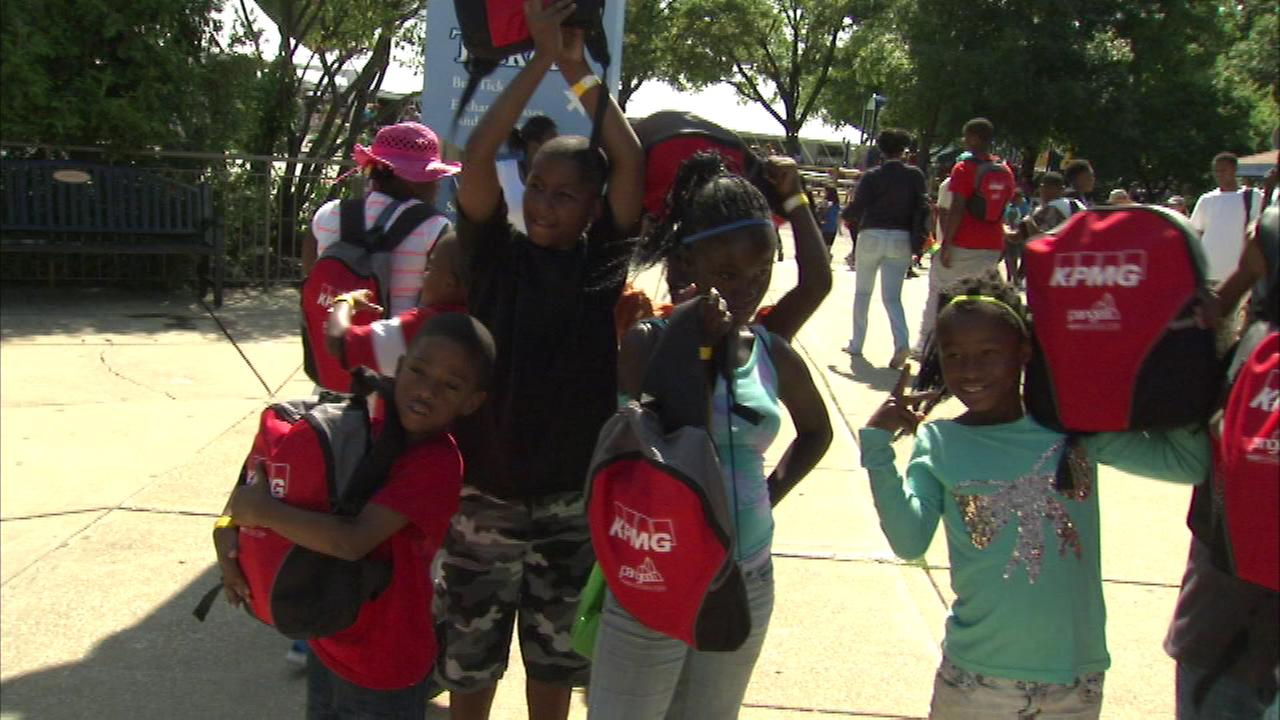 Students receive backpacks and school supplies at Brookfield Zoo
