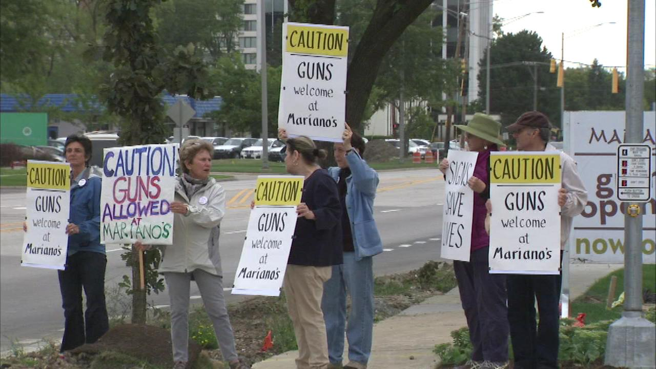 People protested Tuesday outside a Marianos grocery store in suburban Northbrook.