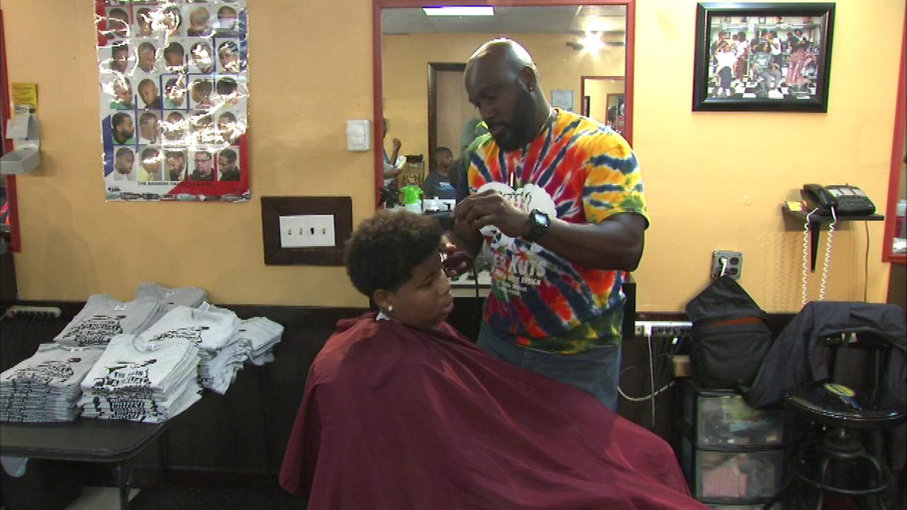 A South Side barbershop is helping kids get ready for school by giving free haircuts.