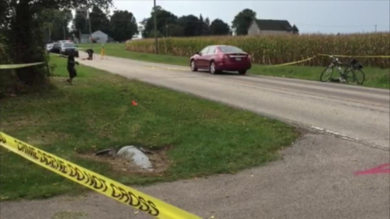 A bicyclist died after colliding with a car in unincorporated Kane County Saturday morning.