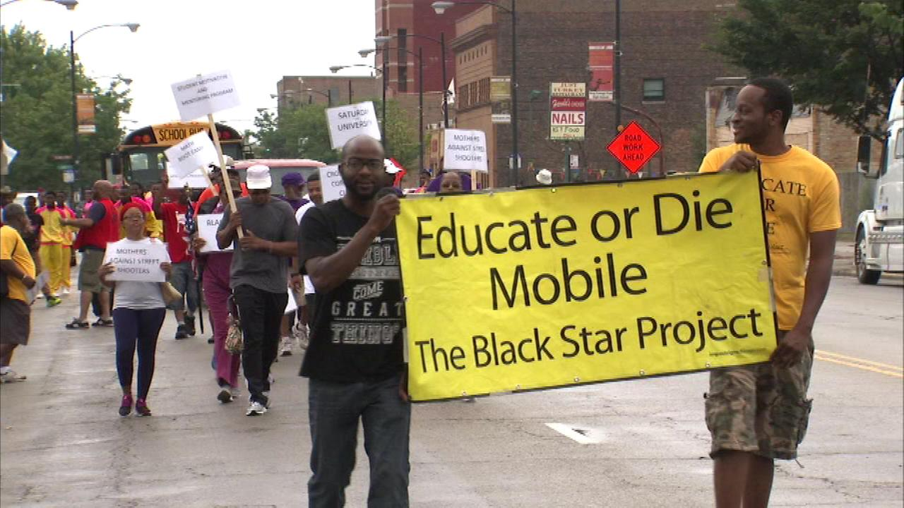 Dozens of families marched through the streets of Chicago Saturday to get communities involved in next weeks Million Father March.