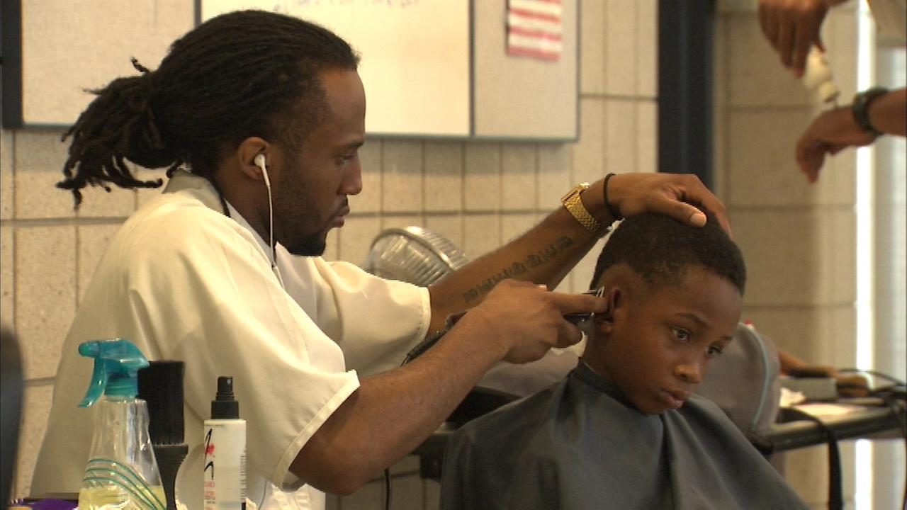 Some Chicago police officers are making kids look sharp as they get ready to head back to school.