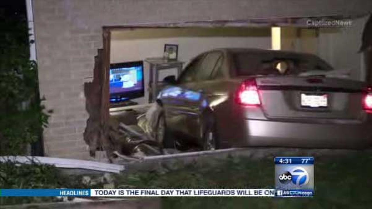 Car crashes into home in Maywood
