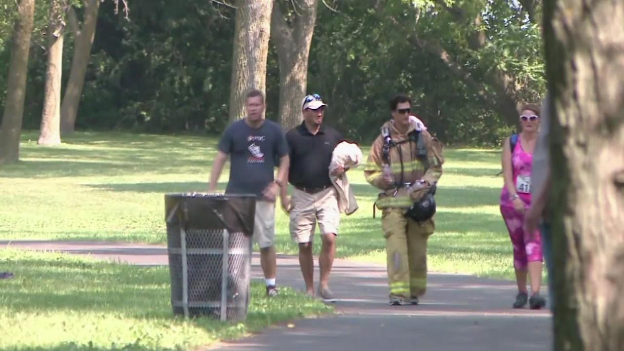 Its hard enough to run a marathon in this hot weather, but imagine doing it in full firefighter gear.
