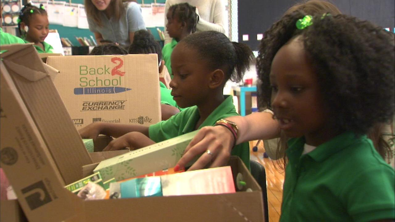 Students at Carter School of Excellence at 57th and Michigan received their own boxes of free school supplies.