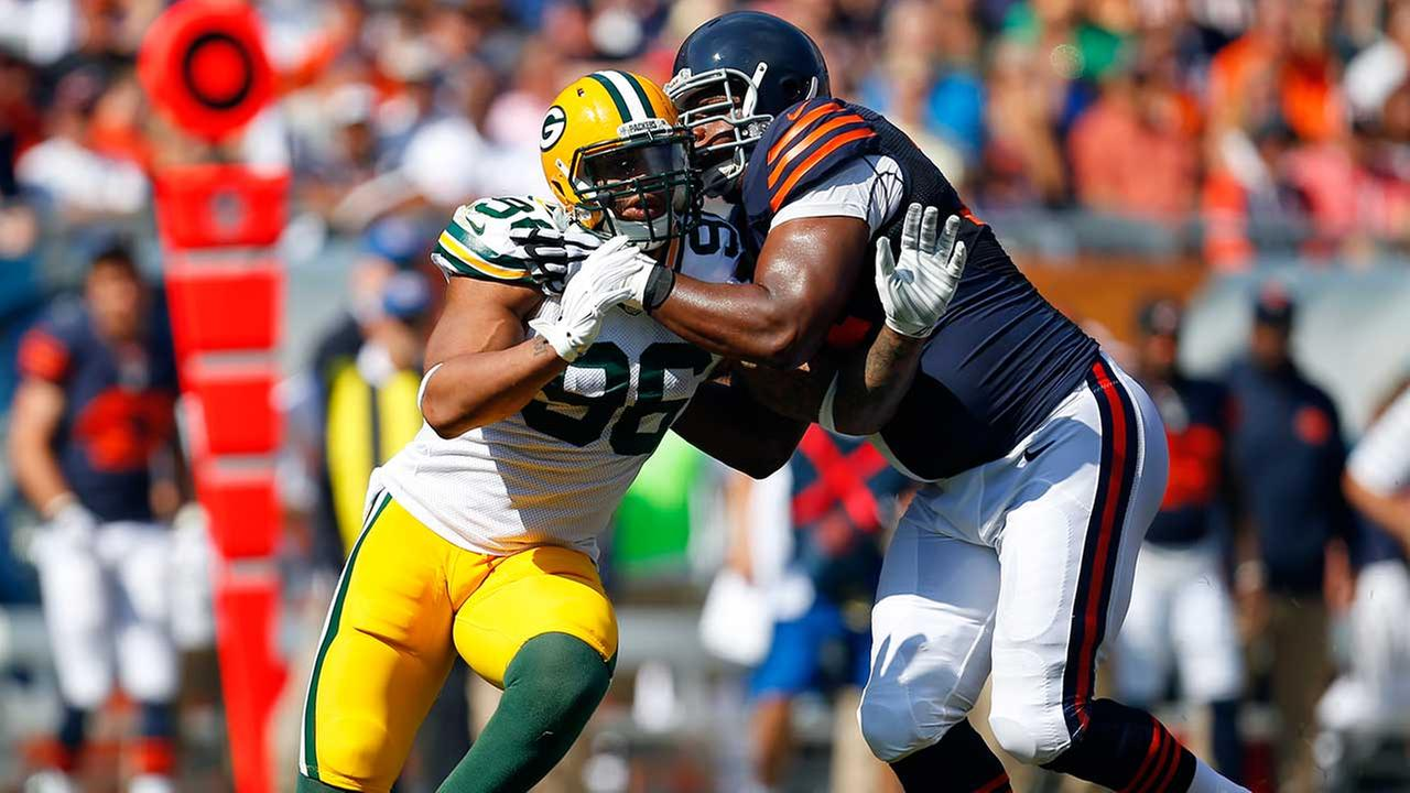 Green Bay Packers outside linebacker Mike Neal (96) is blocked by Chicago Bears tackle Jermon Bushrod (74) during last years game at Soldier Field in Chicago on Sept. 28, 2014.