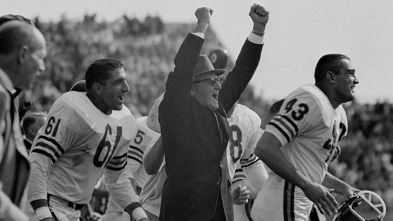 Chicago Bears head coach George Halas celebrates the last second of the game as their team defeated the Green Bay Packers, 10-3, at City Stadium in Green Bay, Wisc., Sept. 15, 1963