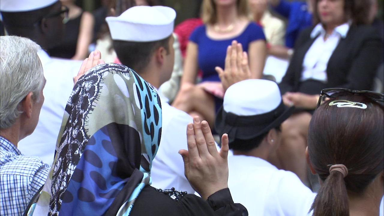 About 60 people from 26 different countries took the oath of allegiance at Daley Plaza on Wednesday.
