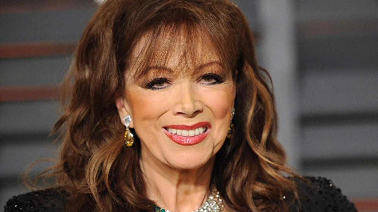 Jackie Collins arrives at the 2015 Vanity Fair Oscar Party on Sunday, Feb. 22, 2015, in Beverly Hills, Calif.