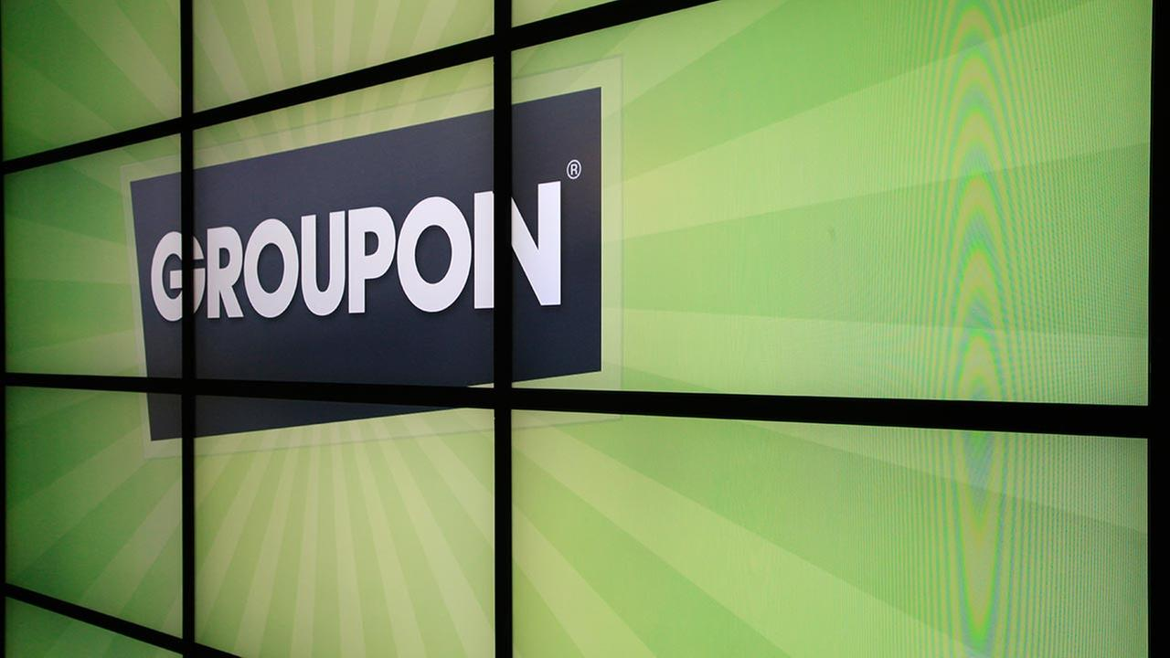 FILE - This Oct. 21, 2011 file photo, shows the Groupon logo inside the online coupon companys offices, in Chicago.