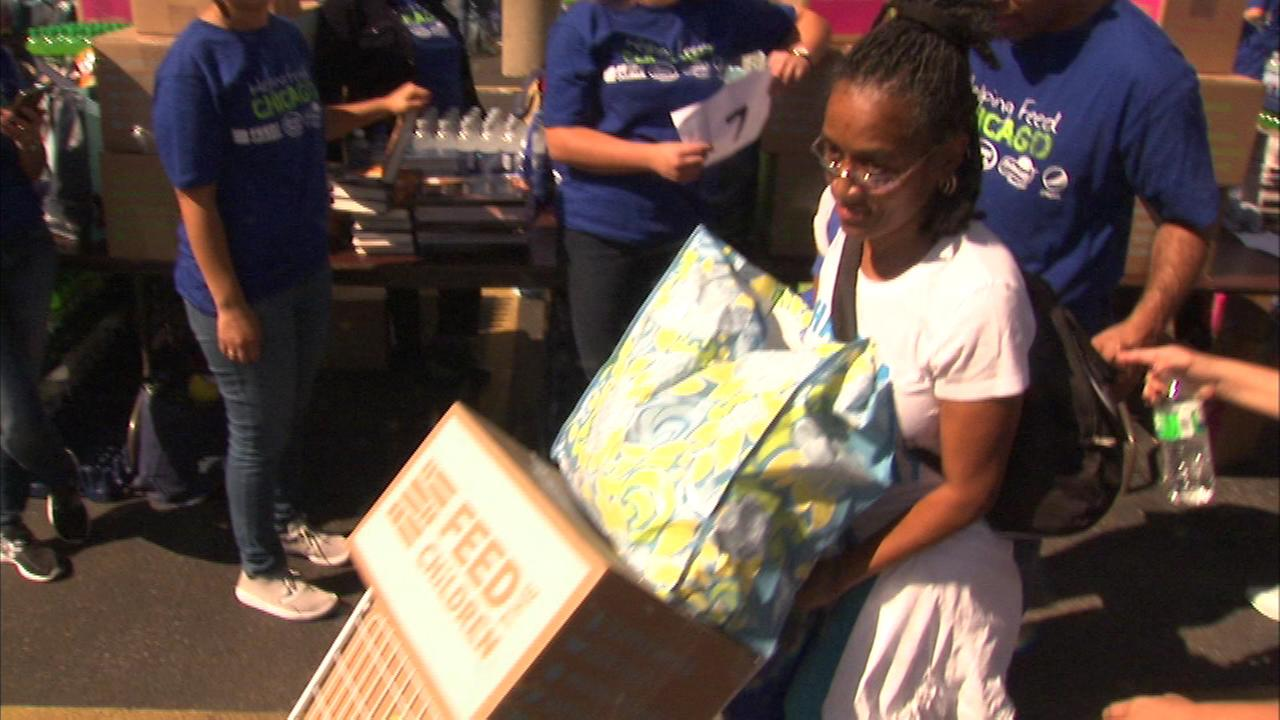 Hundreds of bags filled with food were given to needy families on Chicagos South Side Wednesday