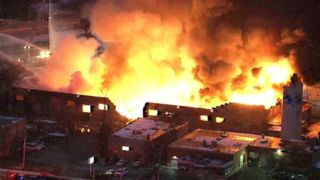 Firefighters battled an extra-alarm blaze at a vacant warehouse in northwest suburban Arlington Heights.