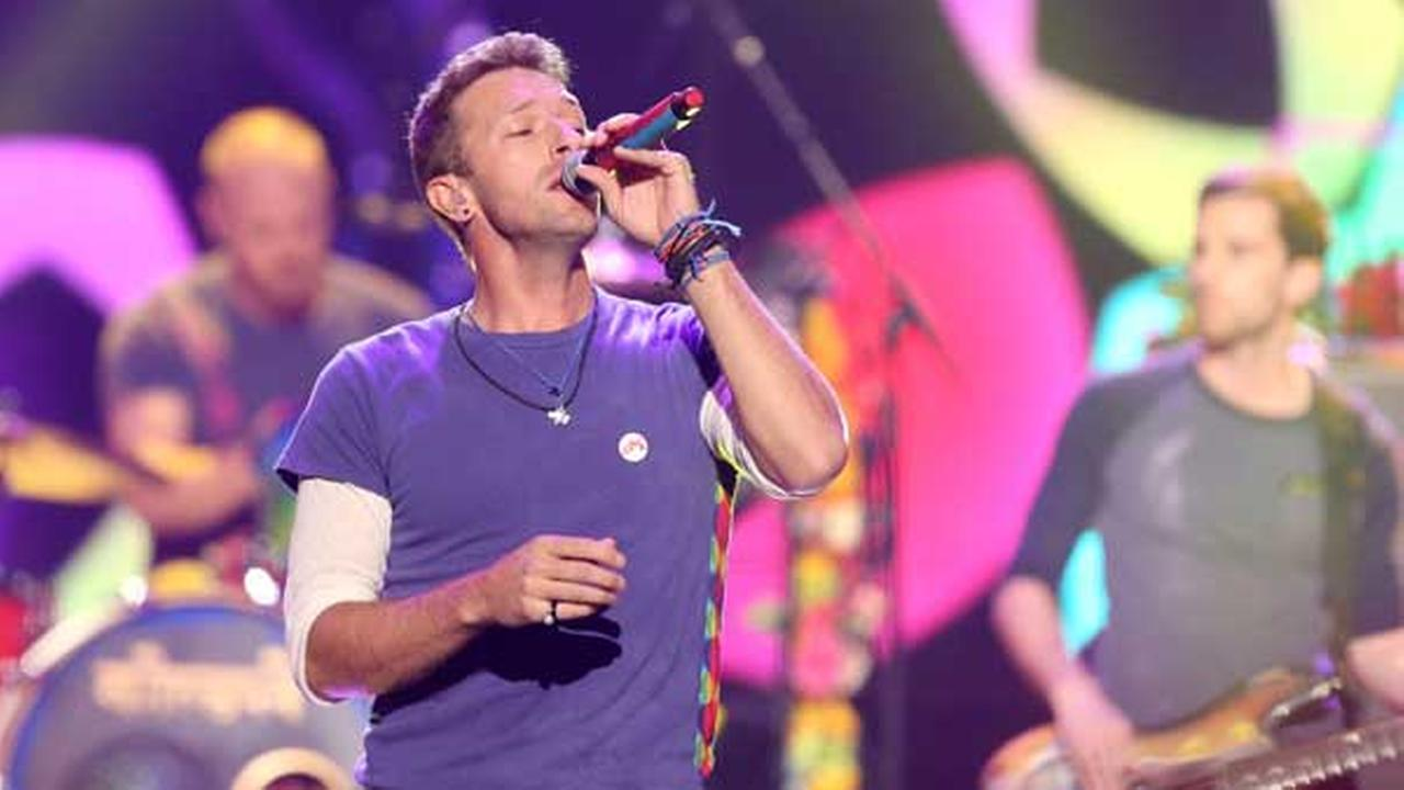 Chris Martin of Coldplay performs at the American Music Awards at the Microsoft Theater in Los Angeles.