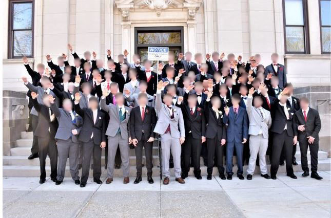 A Wisconsin school district is investigating a photo of a group of high school boys giving what appears to be a Nazi salute, drawing a strong rebuke on social media.