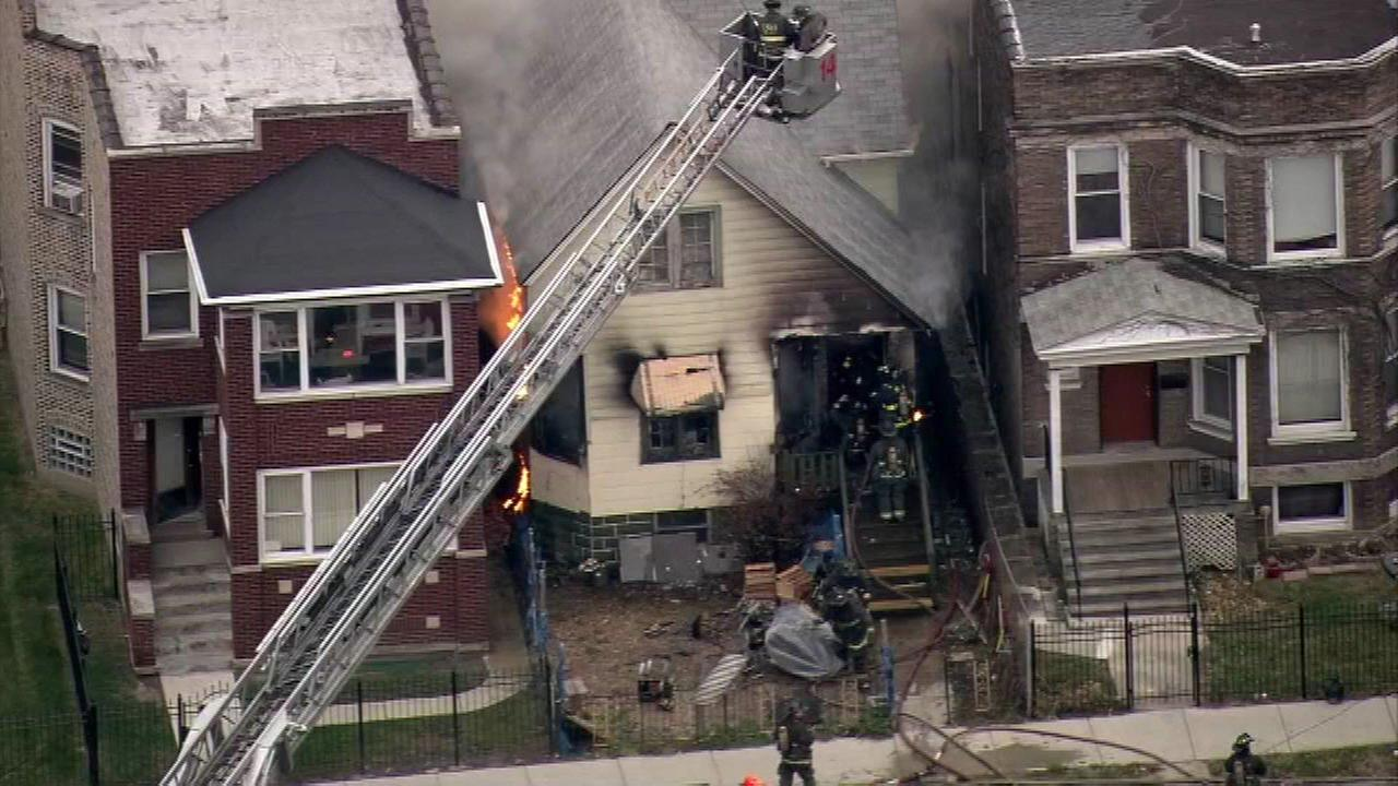 Crews battle house fire in city's West Side