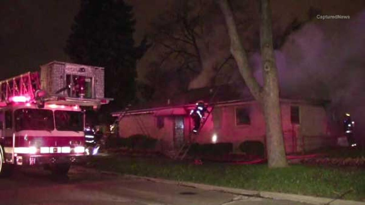 A firefighter is hurt and a familys pet was killed in a large house fire in south suburban Calumet Park.
