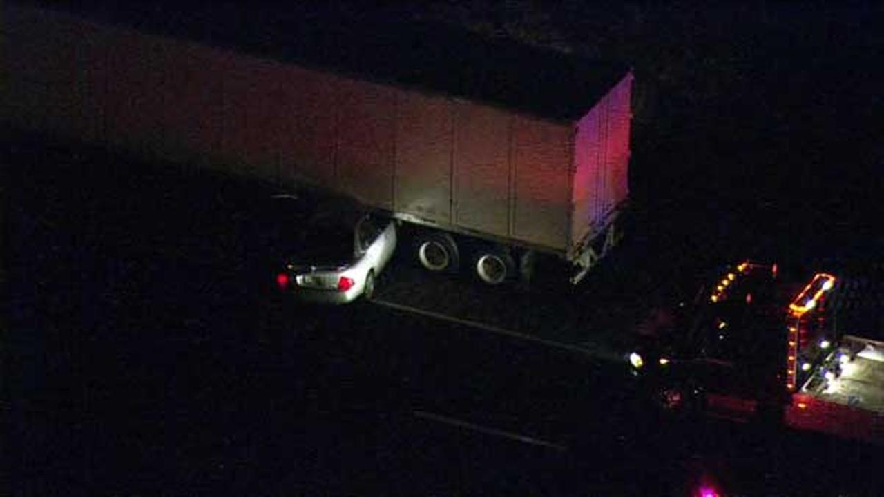 A car became wedged under a semi on southbound I-55 just past Weber Road early Tuesday morning.