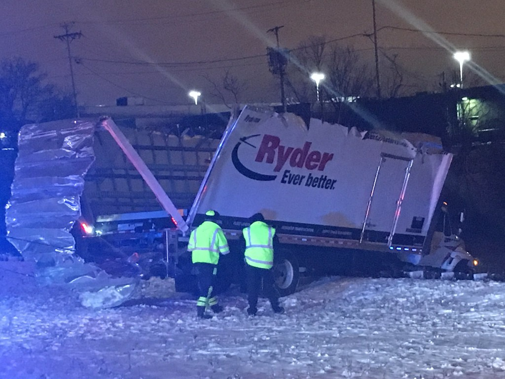 Authorities were searching for the driver of a Ryder truck that was left hanging off a bridge above the Chicago River Monday night.