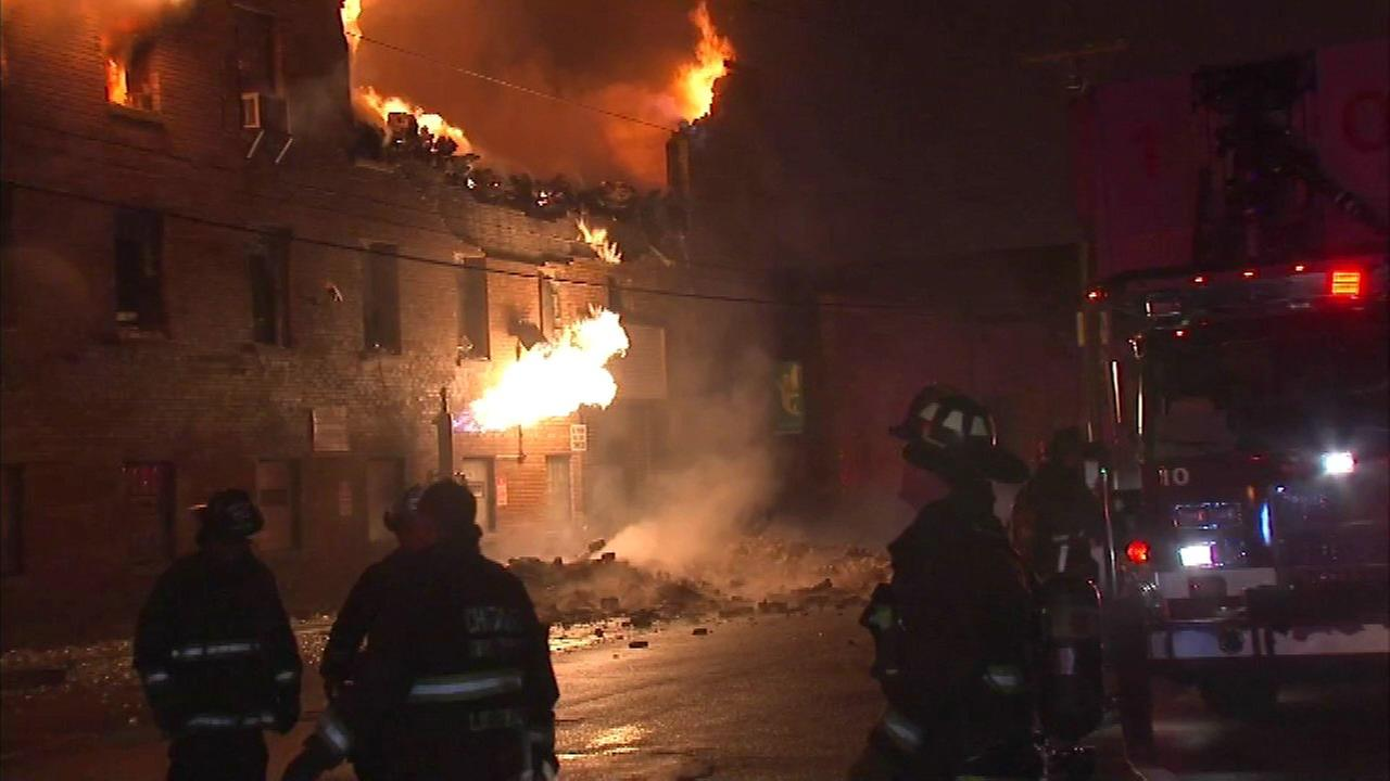 A three-story warehouse near North Rockwell Street and West Barry Avenue caught fire in Chicagos Avondale neighborhood.
