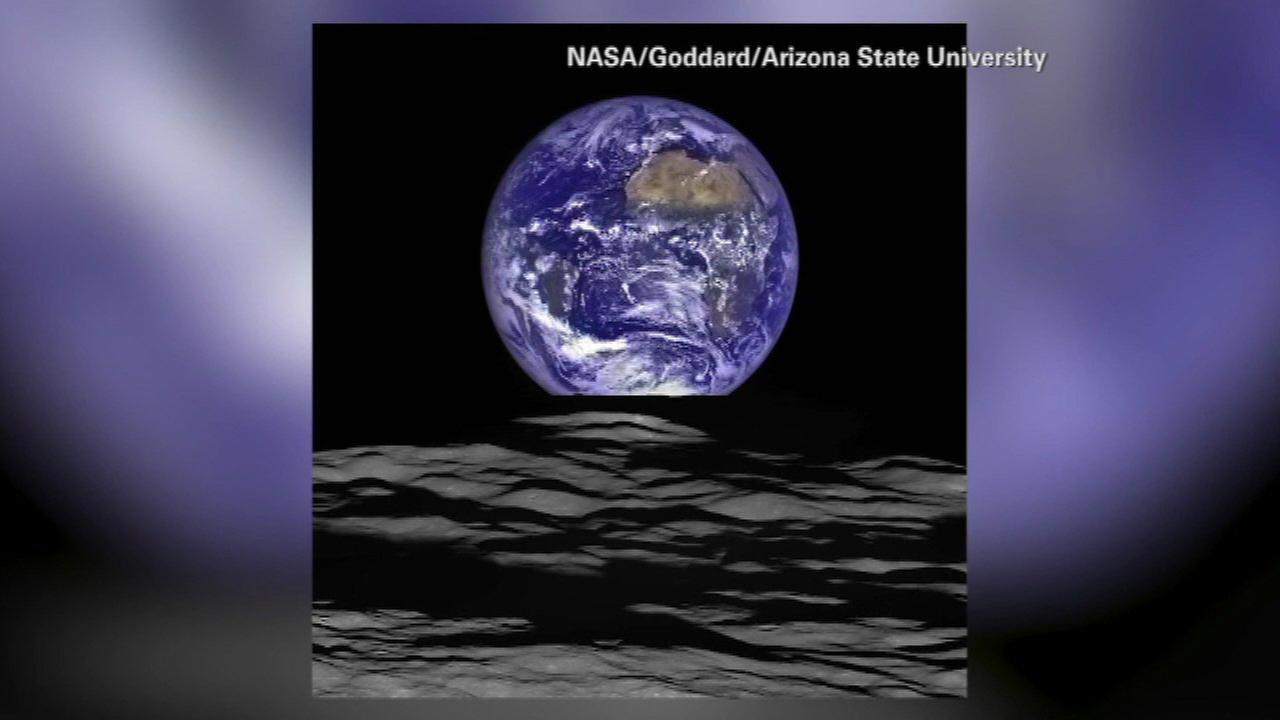 NASA image show Earth rising over lunar horizon