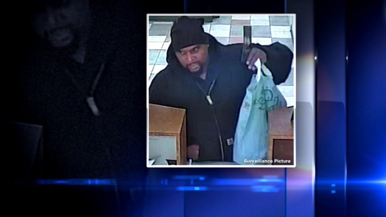 The FBI released surveillance photos of a man suspected of robbing two South Side banks.