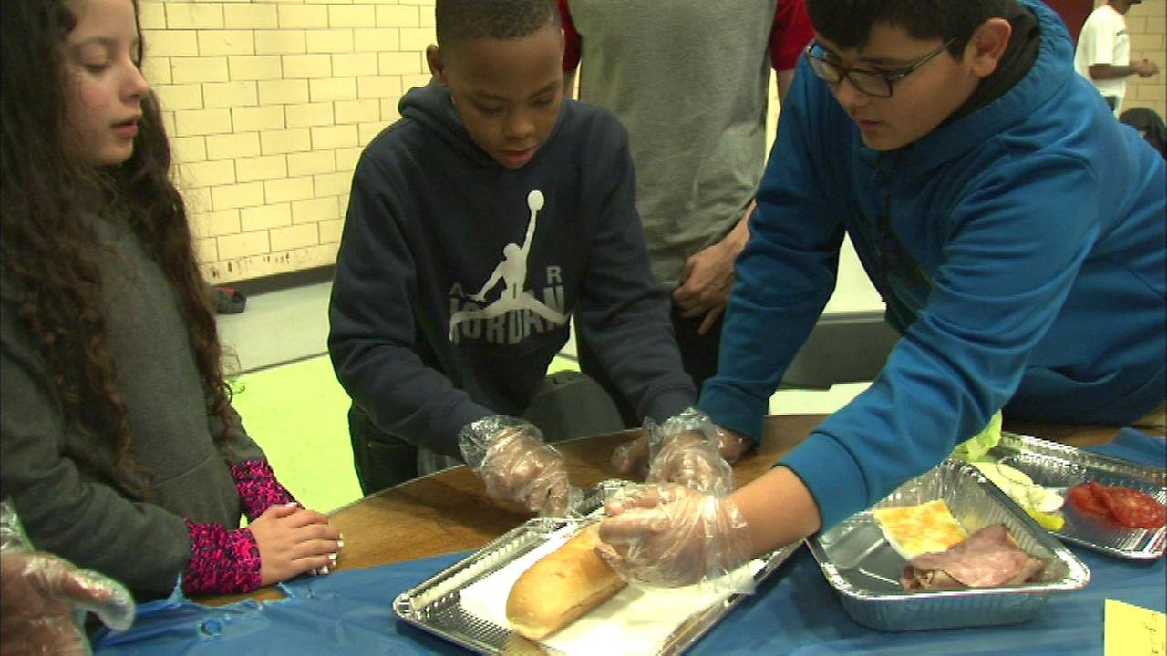 The officers helped the kids build the best - and in some cases, the biggest - sandwich.