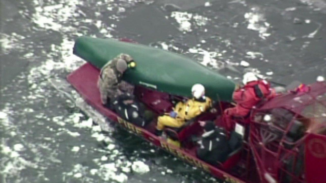 Rescue crews recovered a canoe from icy Lake Beulah near East Troy, Wis., on January 3, 2016.