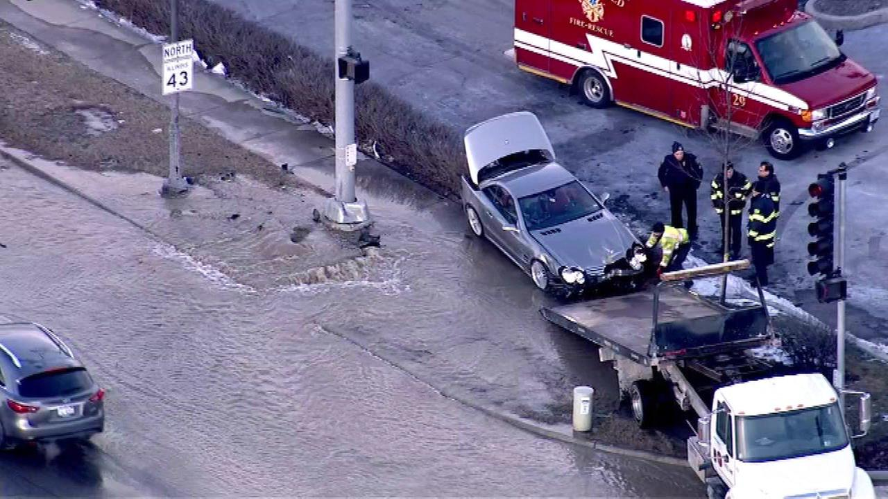 A car struck a fire hydrant and ruptured a water main Friday afternoon in north suburban Glenview.