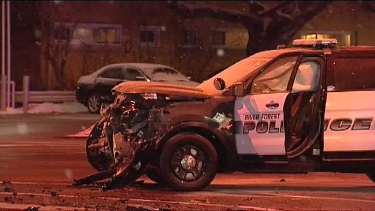 A police SUV and a car collided Tuesday night near Harlem and Division in suburban River Forest.