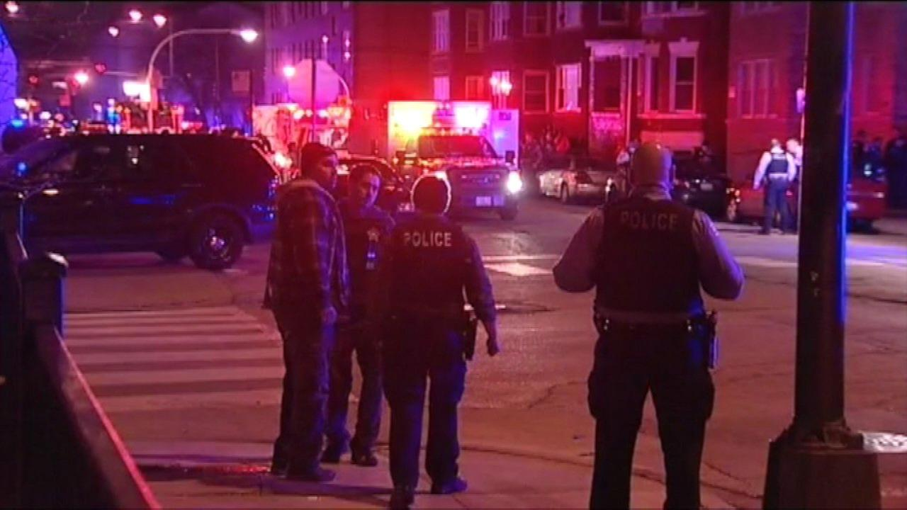 Three Chicago police officers were wounded and a fourth person was reportedly killed in an apparent exchange of gunfire on the citys West Side.