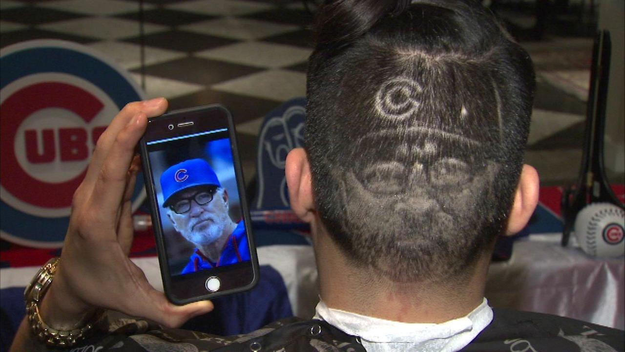 Miguel Rosas cut, shaved and snipped an image of Cubs Manager Joe Maddon on the back of a fans head.