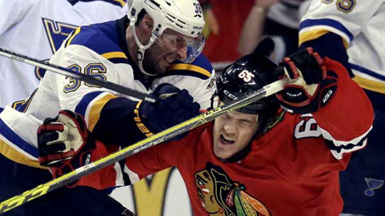 Chicago Blackhawks right wing Andrew Shaw, right, is hit by St. Louis Blues right wing Troy Brouwer during the second period in Game 4 of an NHL hockey first-round Stanley Cup playoff series.