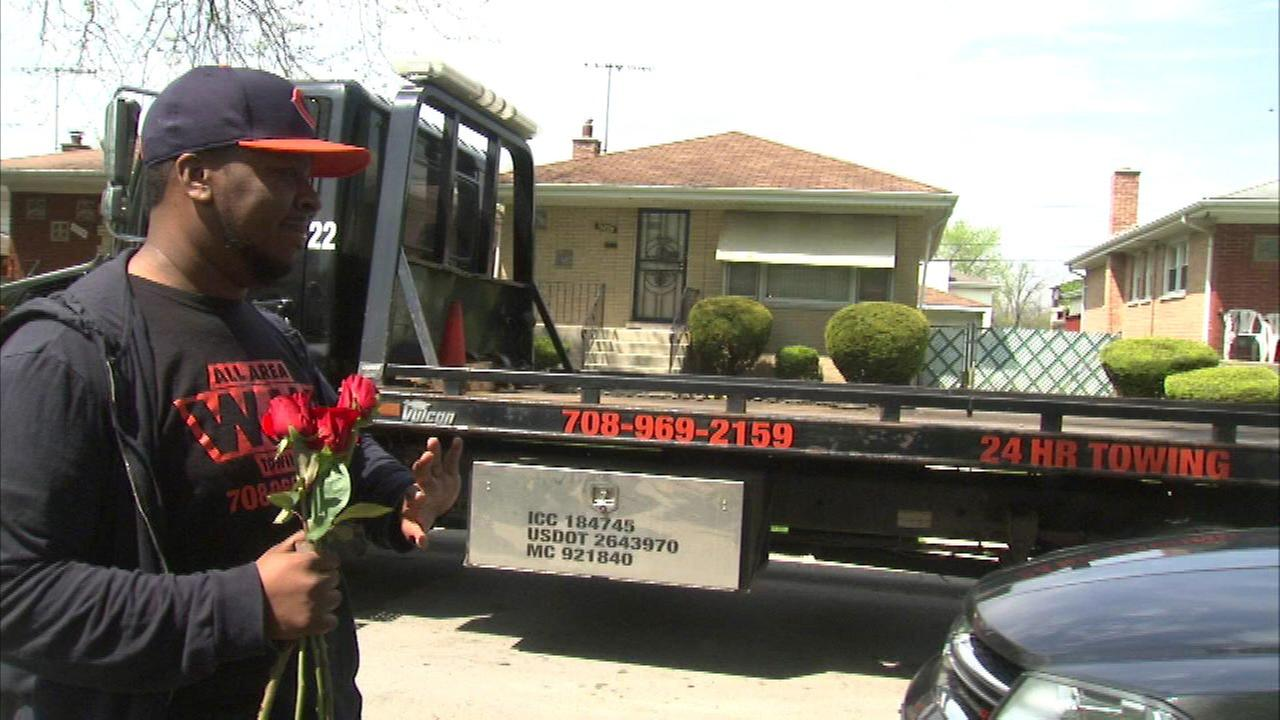 Towing company gives out roses for Mother's Day