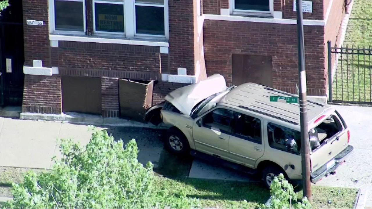 SUV crashes into building