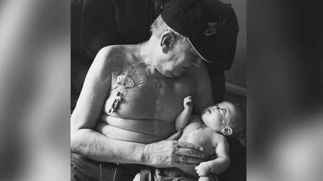 Grandfather Allan Halstead with his grandson Kolbie Gregware who both underwent open heart surgery are photographed together.